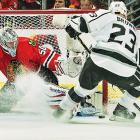 Corey Crawford of the Chicago Blackhawks makes a save on Dustin Brown of the Los Angeles Kings. Crawford saved 24 of 25 shots in a 3-1 Game 1 victory.