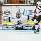 Jonathan Quick of the Los Angeles Kings spread-eagles for a save against the Chicago Blackhawks.