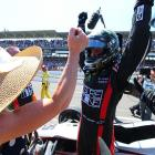 At the end of the 500, Busch stepped out of the IndyCar, raised his arms in triumph and hugged his girlfriend, Patricia Driscoll.