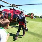 Busch heads to the first of his two helicopters rides on the day.