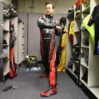 Kurt Busch loosens up for what will be a three-hour race and an average winning speed of 186.563 mph by the victorious Ryan Hunter-Reay.