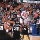 Spurs center David Robinson blocks Marcus Camby of the Knicks in Game 4. San Antonio, led by Robinson and a young Tim Duncan, took up the mantle post-Jordan and defeated the Knicks in five games for its first title.