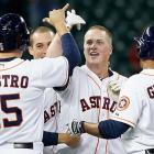 Matt Dominguez celebrates with his teammates after he drove in the winning run with an RBI single in the ninth inning against the Texas Rangers on May 14.