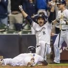 Milwaukee's Ryan Braun celebrates after Jonathan Lucroy scored the game-winning run on May 14 against the Pirates.