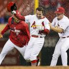 Greg Garcia has water dumped on him by Carlos Martinez (44) and Seth Maness after he was hit by a pitch to force in the winning run in the 12th inning of a May 13 game against the Chicago Cubs.