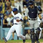 Chone Figgins celebrates as he scores the game-winning run in the 10th inning on a double by Carl Crawford on April 8 against Detroit as catcher Alex Avila looks on.