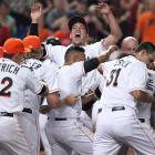 Marlins pitcher Jose Fernandez, center, celebrates with teammates after Giancarlo Stanton hit a game-winning walk-off grand slam in the ninth inning against Seattle on April 18.