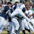 Austin Jackson piles on Ian Kinsler as teammates celebrate his walk-off single against the Kansas City Royals in the 10th inning of an April 2 game.