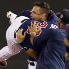 Oswaldo Arcia hoists pinch hitter Danny Santana after his walk-off game-winning RBI off Joakim Soria of Texas in a May 27 game.