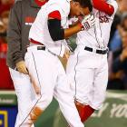 Xander Bogaerts is mobbed by Brock Holt after hitting the walk-off game-winning RBI single in the ninth inning against the Atlanta Braves on May 29.