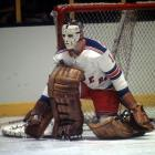 """Beloved on Broadway, Giacomin won 266 games during his NHL career, the first 10 years of which were spent with New York. Until 2014, when Henrik Lundqvist recorded his 50th career shutout, Giacomin was the club's all-time leader, with 49. On October 31, 1975, he was waived and claimed by Detroit, making his Red Wings debut at Madison Square Garden two nights later. The chants of """"Eddie! Eddie!"""" produced one of the most emotional nights in the history of the franchise. He was enshrined in the Hockey Hall of Fame in 1987 and his No. 1 hangs from the Garden rafters."""