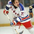 Esposito was hockey's premier goal scorer when he came to New York from Boston (with Carol Vadnais for Brad Park, Jean Ratelle and Joe Zanussi) on Nov. 7, 1975 as part of the franchise's biggest trade. Though he rued the move at the time, Espo became a Ranger fixture, leading the team to a surprise appearance in the Stanley Cup Final in 1979 and later becoming the only man in franchise history ever to serve as captain, coach and GM. He was inducted into the Hockey Hall of Fame in 1984.