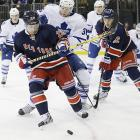 """The post-Olympic stretch drive began on Feb. 27, and as the Rangers stumbled to 4-5-1 start, GM Glen Sather made a major move before the March 5 trade deadline by sending captain Ryan Callahan (who was set to become a UFA), and two draft picks to Tampa Bay for veteran winger Martin St. Louis, 38, a six-time All-Star, two-time scoring champion, and Stanley Cup winner with current Ranger Brad Richards, with whom he played on the Lightning. (New York also acquired defenseman Raphael Diaz from Vancouver for a fifth-rounder.) It took St. Louis time to find his game on Broadway, but he welcomed the big stage. """"I know this is going to be a challenge for me, but I love challenges and I like to rise to the occasion,"""" he said after his Ranger debut against Toronto."""