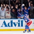 """After the Rangers attended the funeral of Martin St. Louis's mother, they took on the Canadiens In the third round where yet another victim of tragedy -- forward Dominic Moore, who had lost his wife to cancer in January 2013 -- turned out to be a hero for New York. Facing a possible Game 7 in Montreal, where Henrik Lundqvist had historically struggled, the Rangers were rescued by Moore, whose second period goal was the game's only tally, and their stellar netminder, whose acrobatic blocker save for the ages on Montreal's Thomas Vanek in the same frame left MSG in a frenzy. """"It's an unbelievable feeling,"""" Lundqvist said. """"But what took us there is the entire team really stepped up in key moments throughout the year, especially the playoffs."""""""