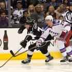 Tyler Toffoli of the Kings scraps with Ryan McDonagh for the puck.