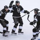 Tanner Pearson (70) celebrates with Jake Muzzin (6) and Justin Williams (14) after Williams scored the game winner.