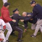 In one of his most memorable moments, a furious Zimmer is restrained after getting into a fight with Red Sox pitcher Pedro Martinez during the ALCS.