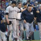 Zimmer leaves the field after the brawl, comforted by pitcher Roger Clemens.