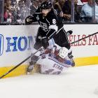 Drew Doughty of theKings and Marc Staal collide behind the Rangers net.