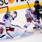 Henrik Lundqvist makes one of his 39 saves.