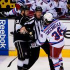 Kyle Clifford and Mats Zuccarello are held back from one another.