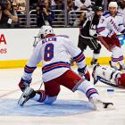A shot by Jarret Stoll slides under defenseman Kevin Klein's stick to cut the Rangers' lead to 2-1 at 1:46.