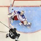 New York Rangers goaltender Henrik Lundqvist searches for the airborne puck to make a save on Anze Kopitar of the Los Angeles Kings in Game 1 of the Stanley Cup Finals.