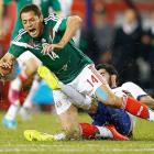 """Javier """"Chicharito"""" Hernandez receives a hard foul from Portugal's Neto during an international friendly at Gillette Stadium in Foxboro, Mass."""