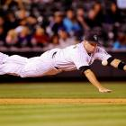 Third baseman Michael Cuddyer #3 of the Colorado Rockies just misses a tough ninth-inning grab against the Arizona Diamondbacks.