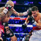 Miguel Cotto lands a left to the head of Sergio Martinez in the third round of the WBC Middleweight Championship fight at Madison Square Garden in New York City. Cotto won by a TKO in the ninth round.