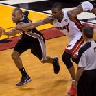 Chris Bosh, defending against Patty Mills here, took only four shots and scored nine points for the Heat, who for the second straight year will have to overcome a 2-1 finals deficit after being blown out in Game 3.