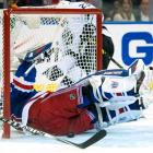 Henrik Lundqvist gives up a goal to Dustin Brown in the second period.