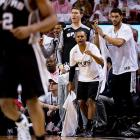 Patty Mills, center, roots on his teammates. He came off the bench to score 14 points -- two more than Chris Bosh.