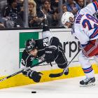 Dominic Moore of the New York Rangers checks Jarret Stoll.