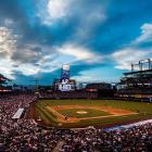 A look at Coors Field from the press box as the sun sets during a game between the Atlanta Braves and the Colorado Rockies in Denver.