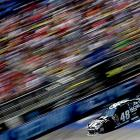 Jimmie Johnson races at the NASCAR Sprint Cup Series Quicken Loans 400 in Brooklyn, Michigan.