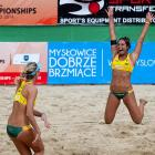 Mariafe Artacho (right) and Nicole Laird of Australia celebrate their victory and gold medal in the FIVB U-23 World Championships in Myslowice, Poland.