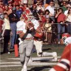 Georgia QB Buck Belue was having an atrocious game with only 52 total passing yards and two INTs, but thanks to Hershel Walker the Dogs were only trailing 21-20 with 1:31 remaining. Facing a third-and-7 on the Georgia 7, Belue faded back and found receiver Lindsay Scott in the middle of the field for the first down. Two Gators defenders appeared to be in position for the tackle, but both fell, allowing Scott to run free down the left sideline making his way for the improbable 93-yard touchdown.