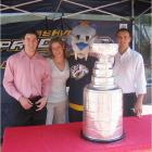 Here is the Stanley Cup in Nashville, Tenn., outside the First Tennessee Bank.  Pictured is Erich Wilhelm (Predators Community Relations Coordinator), Andee Boiman (Predators Amateur & Youth Hockey Coordinator), Gnash (Predators team Mascot) and T.J. Coffey (Predators Community Relations Intern). -- Andee Boiman