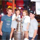This is a picture of Lindsey and Erin Kisielewski of Sarasota, Fla., enjoying a taste of the Cup with Marty St. Louis and Brad Richards. -- Stephanie Kisielewski