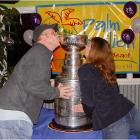 Martin and Angie get friendly with the Cup on Clearwater Beach after the Lightning won it.