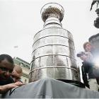 The Stanley Cup is hockey's ultimate treasure. Yet it's not buried in the ground or in some sunken ship. The NHL lets its fans touch it, hug it, kiss it -- and have a photo made with it. So when we asked you, SI.com readers, to send us your pictures with the Cup, you delivered. Here's a sampling of the photos we received (alas, we got so many we couldn't use 'em all).
