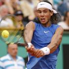 After winning only one game in the first set, Nadal took advantage of Federer's tentative play and defended his title at Roland Garros, thwarting Federer's bid to hold all four major titles at the same time.    Nadal leads series 6-1.