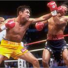 """Camacho entered the ring in a black-leather getup complete with visored helmet. He probably should have kept the headgear on, as the self-styled Macho Man was, at 35, past his prime and -- though ever the showman -- no match for the 24-year-old Golden Boy. De La Hoya pounded the elusive Camacho and, though he decked him in the ninth round, had to settle for a lopsided decision. """"He took some shots,"""" said De La Hoya. """"I don't know how he stood up to them."""""""