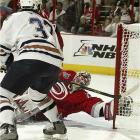 Edmonton's Michael Peca capped a high-scoring opening period by putting a shot past Cam Ward with only 17.4 seconds left. Peca's tally put the Oilers up 3-2 heading into the first intermission.
