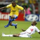 Robinho goes airborne to avoid a tackle from France's Sylvain Wiltord.