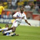 Brazil's Juan trips up France's Patrick Vieira.