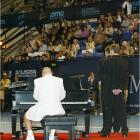 """At the """"Night at the Net"""" benefit, held before the Mercedes-Benz Cup in Los Angeles, Andre Agassi excites the crowd by showing off his piano skills."""