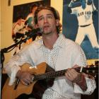 """At a concert for the cast members of """"Desperate Housewives,"""" Cincinnati Reds starter Bronson Arroyo showcases a voice as enchanting as his off-speed stuff. Arroyo, who once lent vocals to the Dropkick Murphys, taught former teammate Kevin Millar how to play the guitar."""