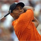 Two-time British Open winner Tiger Woods fired a stellar 5-under 67 Thursday, putting him one behind leader Graeme McDowell.